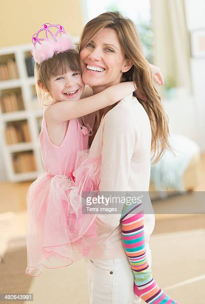 Portrait of mother and daughter (4-5) wearing tutu, Jersey City, New Jersey, USA