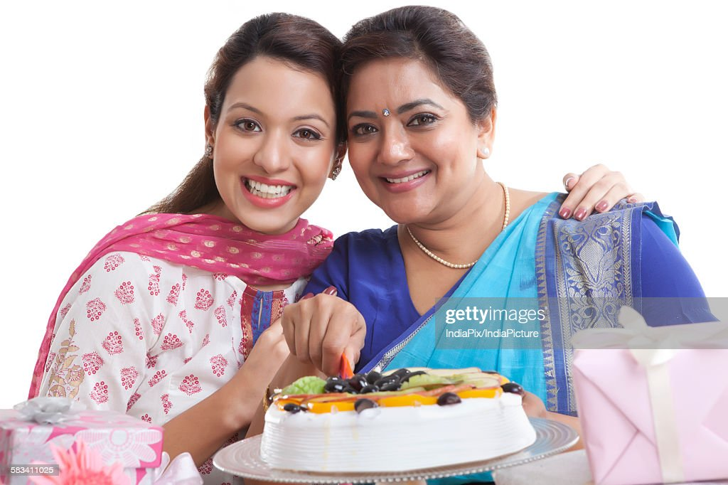 Portrait of mother and daughter with birthday cake : Stock Photo