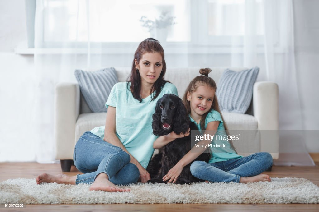Family Sitting With Dogs Together On A Meadow Royalty Free ... |Dog Mom And Daughter