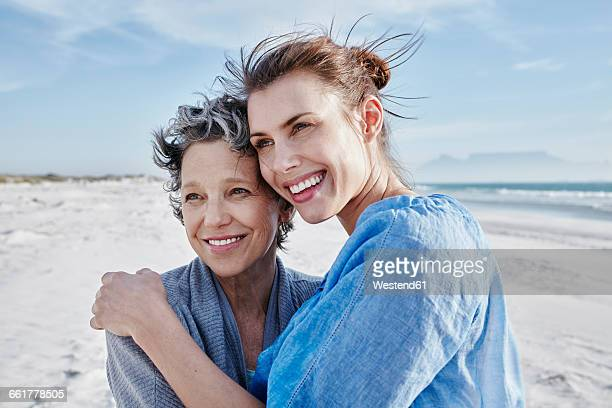 Portrait of mother and her adult daughter on the beach