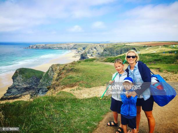 portrait of mother and her sons near the seaside - cornwall england stock pictures, royalty-free photos & images