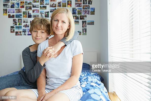 Portrait of mother and son in bedroom