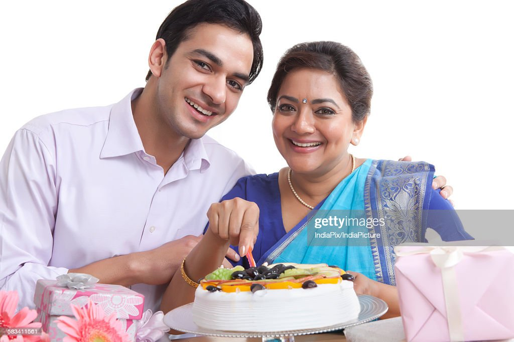 Portrait of mother and son with birthday cake : Stock Photo