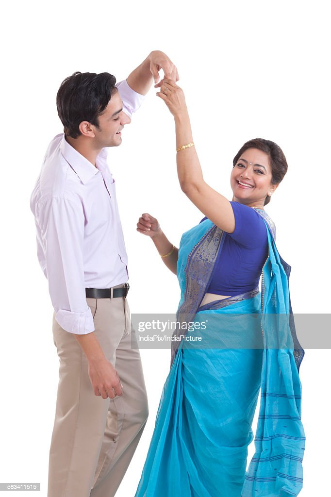 Portrait of mother dancing with her son : Stock Photo