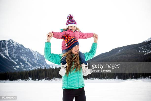 Portrait of mother giving piggy back ride to daughter (4-5), Bozeman, Gallatin County, Montana, USA