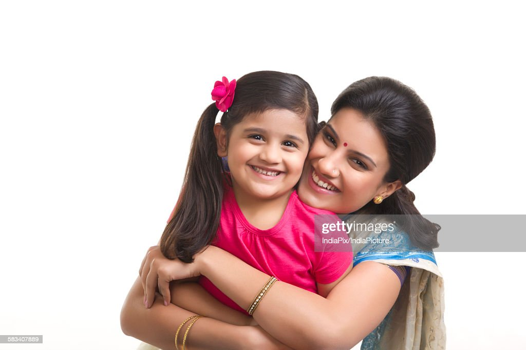 Portrait of mother hugging daughter : Stock Photo