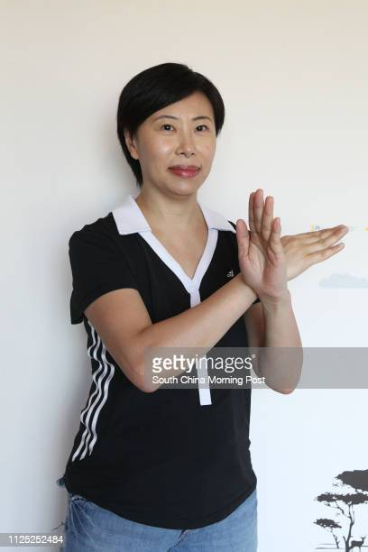Portrait of mother Shirley Chan Sauyee gestures about do's and don't's at home in Sha Tin 13NOV11