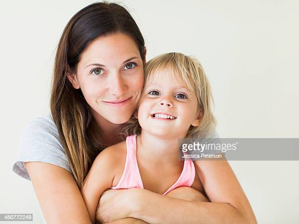 Portrait of mother with daughter (2-3)