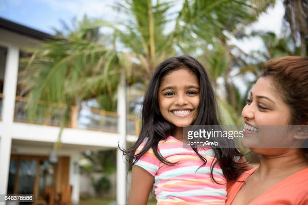 portrait of mother with daughter smiling - sri lankan culture stock pictures, royalty-free photos & images