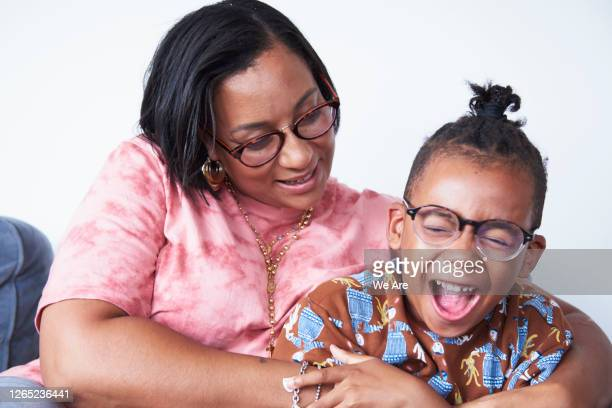 portrait of mother with happy child - laughing stock pictures, royalty-free photos & images