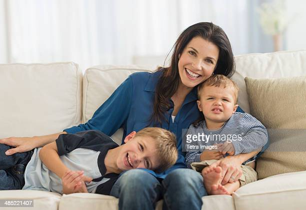 Portrait of mother with two sons (12-17 months, 6-7)