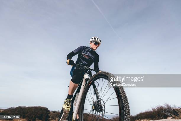 portrait of mountain biker out on a training ride - cross country cycling stock pictures, royalty-free photos & images