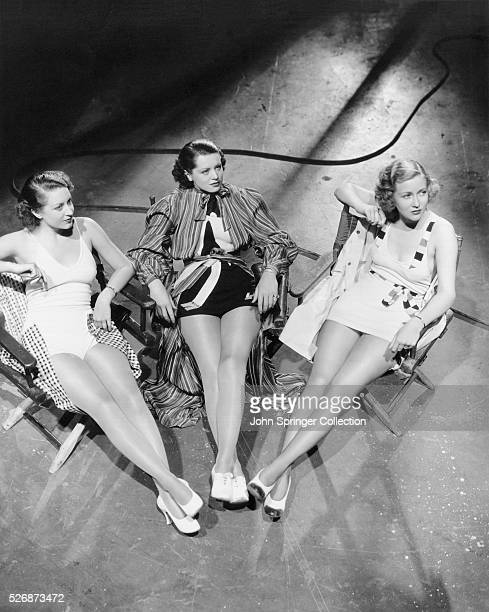 Portrait of movie extras Margaret Carthew Betty McIvor and Helen Ericson on the set of the 1935 film The Case of the Lucky Legs