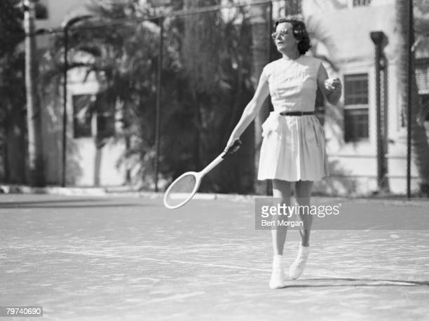 Portrait of Mrs Edward B McLean on the court during a tennis match Palm Beach Florida 1940s