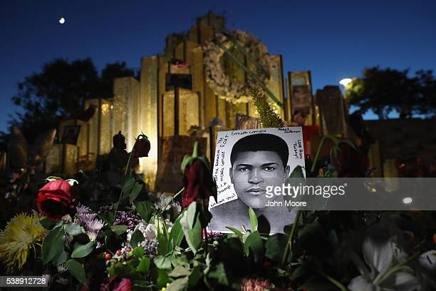 A portrait of Muhammad Ali under a crescent moon stands at a memorial outside the Muhammad Ali Center on June 8 2016 in Louisville Kentucky A funeral...