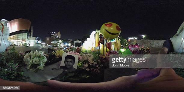 A portrait of Muhammed Ali is displayed at a makeshift shrine at the Muhammad Ali Center after the former champ was laid to rest on June 10 2016 in...