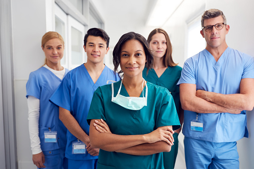 Portrait Of Multi-Cultural Medical Team Standing In Hospital Corridor 1204177269