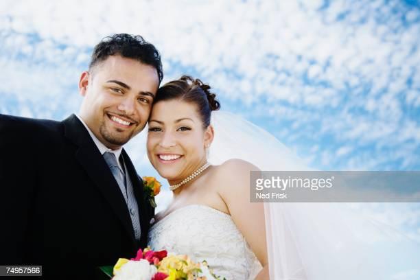 Portrait of multi-ethnic bride and groom