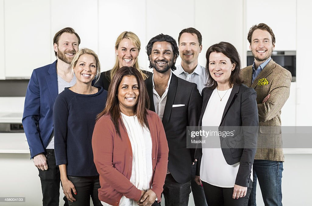 Portrait of multi-ethnic business people standing together in office : Stock Photo