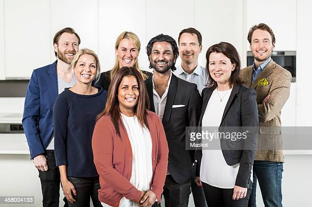 Portrait of multi-ethnic business people standing together in office