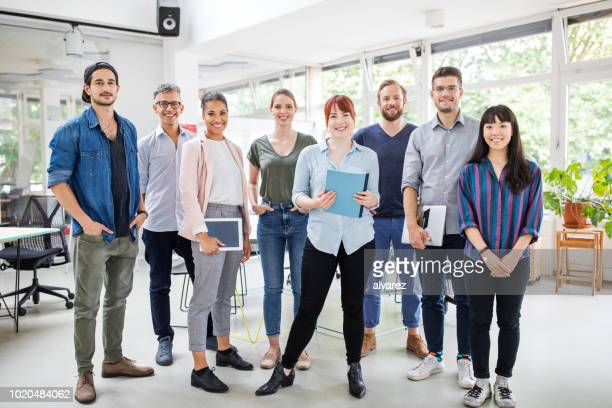 portrait of multi-ethnic business team - medium group of people stock pictures, royalty-free photos & images