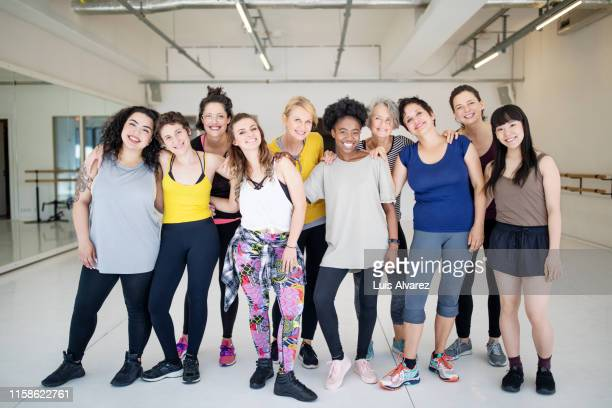 portrait of multi-ethnic females at fitness dance studio - female friendship stock pictures, royalty-free photos & images