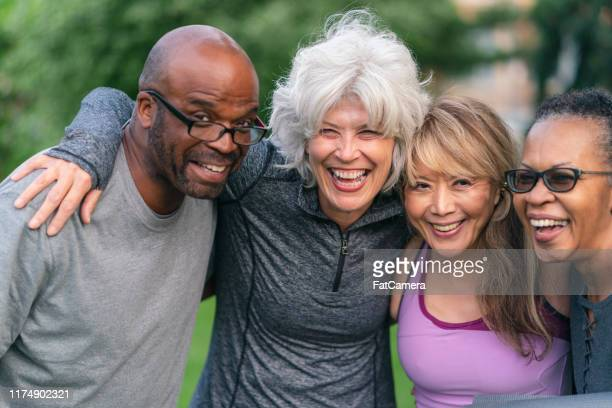 portrait of multi-ethnic group of senior friends outdoors - independence stock pictures, royalty-free photos & images