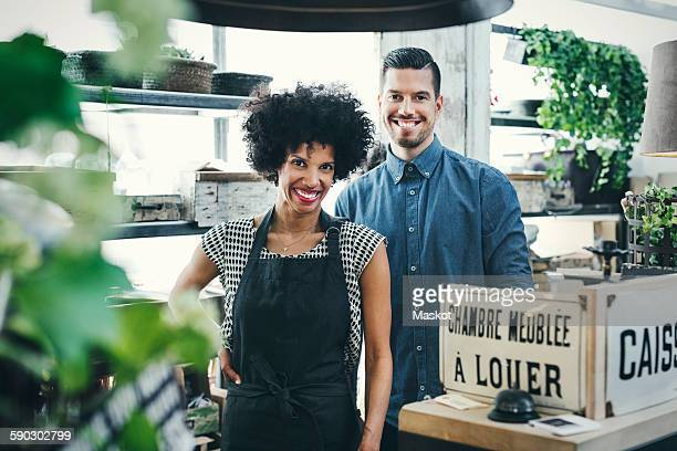 Portrait of multi-ethnic workers standing at checkout counter