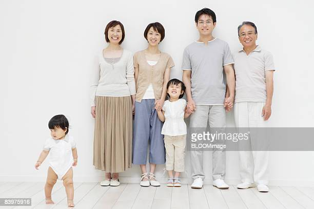 portrait of multi-generation family, baby girl walking away - 数人 ストックフォトと画像