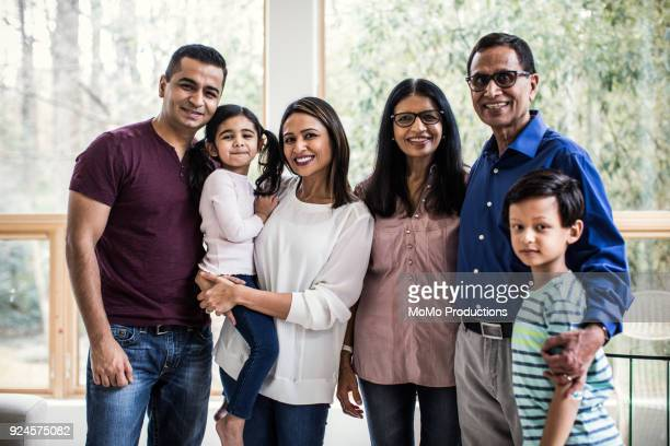 portrait of multi-generational family at home - indian subcontinent ethnicity stock pictures, royalty-free photos & images