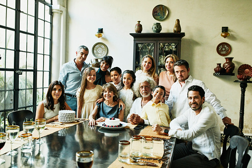 Portrait of multigenerational family gathered in dining room during celebration dinner - gettyimageskorea