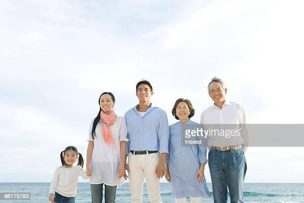 Portrait of multigenerational family in beach
