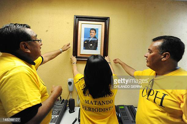 A portrait of murdered journalist Alfredo Villatoro is hung by his widow Karen on the wall of which was his cabin at the HRN la Voz de Honduras...