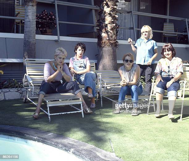 Portrait of music group the GoGo's as they pose by the swimming pool in the courtyard of the Tropicana Hotel Los Angeles California 1979 Pictured are...