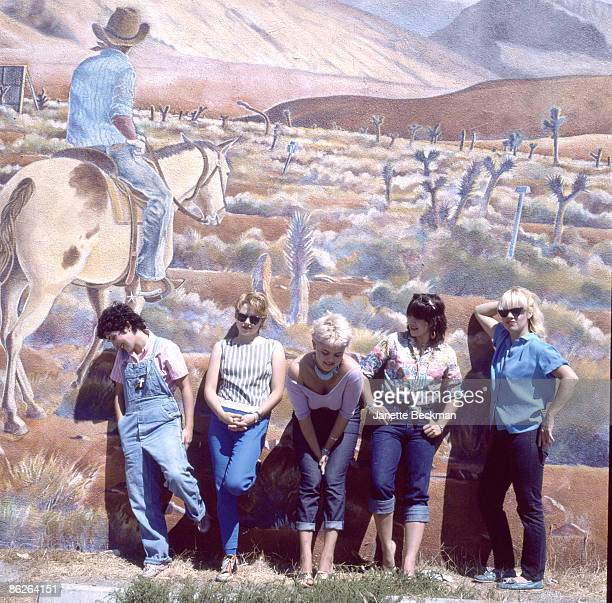 Portrait of music group the GoGo's as they pose in front of a large outdoor wall mural in Venice Beach Los Angeles California 1979 Pictured are from...