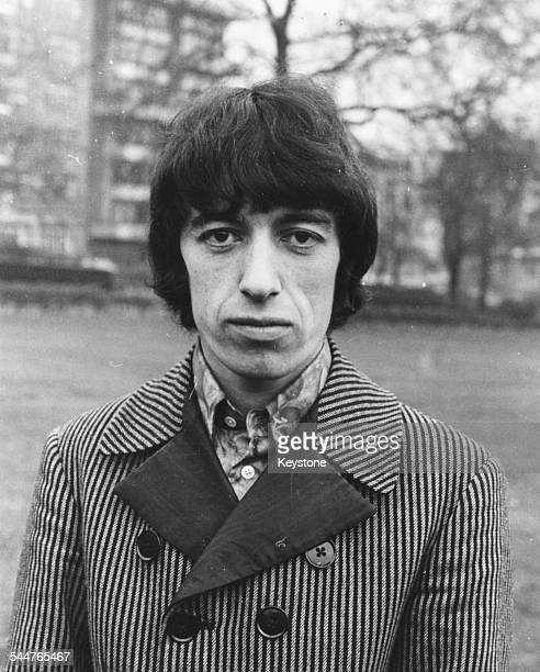 Portrait of musician Bill Wyman of the band 'The Rolling Stones' wearing a stripe jacket January 1967