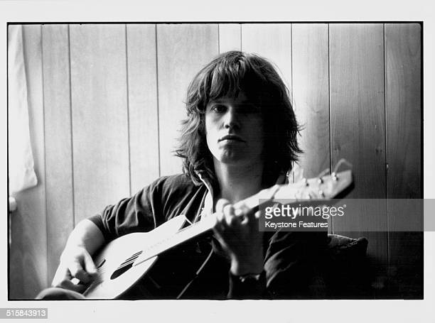 Portrait of musician Chris Jagger with his guitar brother of pop singer Mick Jagger circa 1968