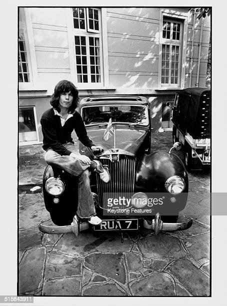 Portrait of musician Chris Jagger with sitting on the bonnet of his car brother of pop singer Mick Jagger circa 1968