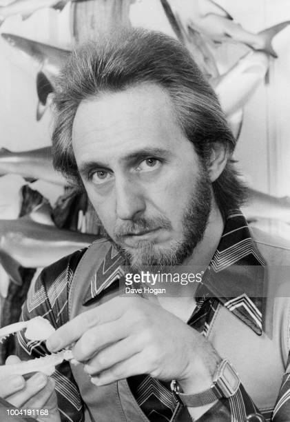 Portrait of musician John Entwistle of the band 'The Who' holding a model of a fish from his fish collection circa 1985 The bassist started fishing...