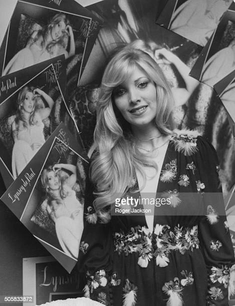 Portrait of musician Lynsey De Paul surrounded by posters of herself at a press reception in the Dorchester Hotel London November 28th 1974