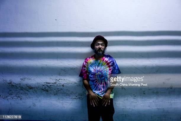Portrait of musician MC Yan at Wing Hing Industrial Building in Tsuen Wan MC Yan is best known as one of the first Chinese rappers and graffiti...