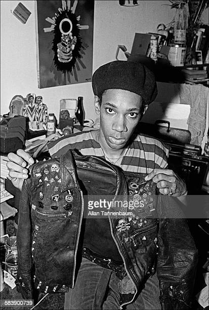 Portrait of musician Neon Leon Webster in his room at the Chelsea Hotel as he holds up Sid Vicious' jacket New York New York October 12 1978 Vicious...