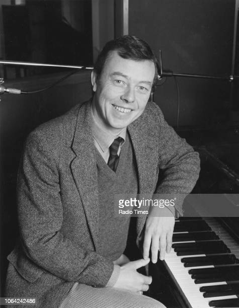 Portrait of musician Peter Skellern sitting at a piano, 1987.