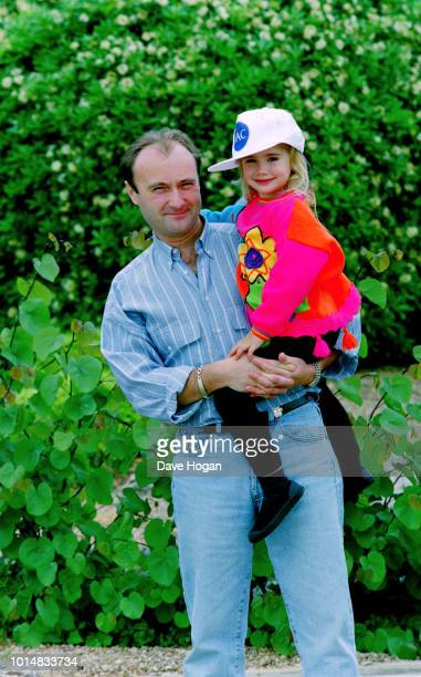 Portrait of musician Phil Collins with daughter Lily Collins while on tour in Japan circa 1988