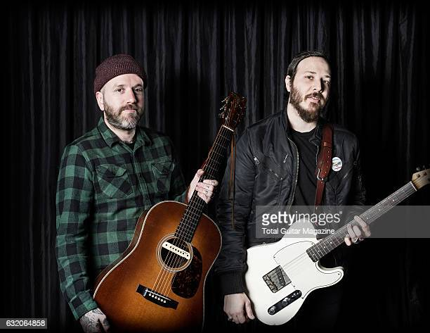 Portrait of musicians Dallas Green and Dante Schwebel guitarists with indie rock group City And Colour photographed before a live performance at...