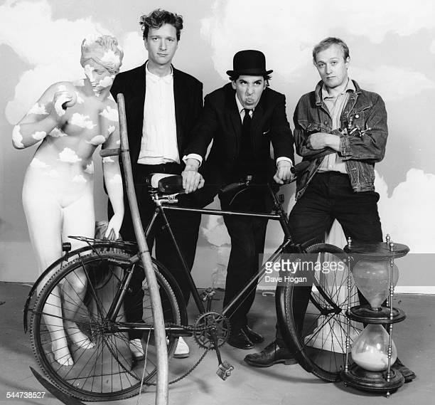 Portrait of musicians Glenn Tilbrook and Jools Holland with actor Ade Edmondson as they appear in a music video for the band 'Squeeze' July 29th 1987
