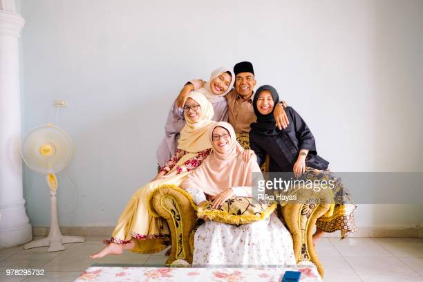 portrait of muslim family on eid mubarak - indonesian culture stock pictures, royalty-free photos & images