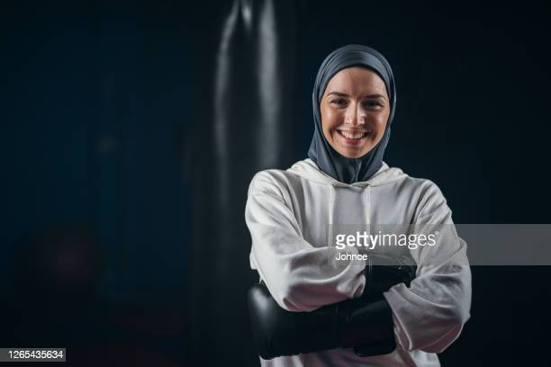 portrait of muslim female boxer - religious dress stock pictures, royalty-free photos & images