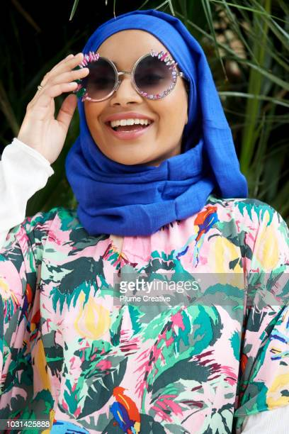 Portrait of Muslim woman in glamorous sunglasses