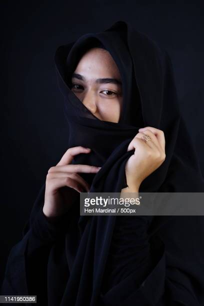 portrait of muslim woman - heri mardinal stock pictures, royalty-free photos & images